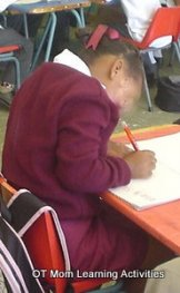 child has elevated shoulder during writing task