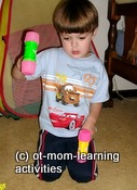 Using toy hammers for coordination skills