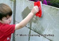 preschooler scrubbing a wall