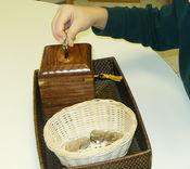 Using coins for fine motor skills