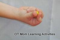 rolling small balls of plasticine