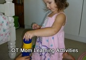 toddler stacking blocks using hand-eye coordination
