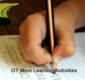 Child using a stiff pencil grip
